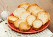 Garlic and garlic bread Stock Photos