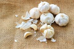 Garlic. S are on brown background Royalty Free Stock Photography