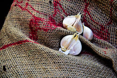 Garlic with a gunny bag. Garlic and a gunny bag in the market Stock Photography