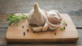 Garlic head on a wooden board Stock Photos