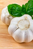 Garlic heads and basil close up Stock Image