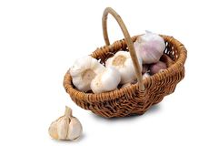 Garlic heads in basket Stock Images