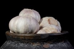 Garlic in a clay pot Stock Images