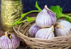 Garlic heads in wicker basket Stock Photo