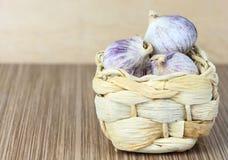 Garlic heads in wicker basket Royalty Free Stock Image