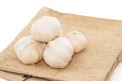 Garlic  heap  on  cloth sack Stock Photos