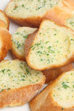 Garlic & Herb Bread. Close-up of crusty baguette with garlic & herb butter Stock Photos