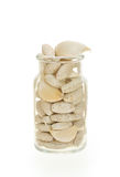 Garlic and herbal supplement pills isolated Royalty Free Stock Images