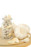 Garlic and herbal supplement pills isolated Royalty Free Stock Photos