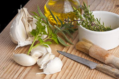 Garlic, herbs and olive oil Stock Photos