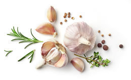 Garlic and herbs on white background. Garlic and herbs isolated on white background, top view stock photography