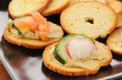 Garlic hummus canapes Stock Image