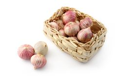 Garlic In A Wicker Basket Stock Photos