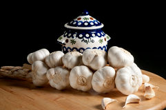 Garlic Jar with Braid of Whole Garlic. Garlic Jar with Whole Cloves of Garlic royalty free stock image