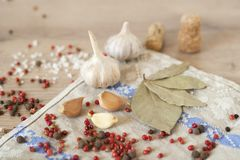 Garlic, laurel and red pepper on wood background Stock Photo