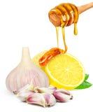 Garlic and lemon with honey Stock Photos