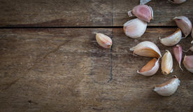 Garlic lobes. Seasoning herb and spicy, had been placed on the brown wooden plate Royalty Free Stock Image
