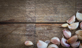 Garlic lobes. Seasoning herb and spicy, had been placed on the brown wooden plate Royalty Free Stock Images