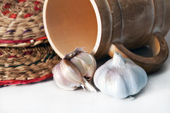 Garlic. Lying on a light background Royalty Free Stock Images