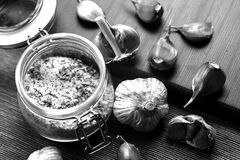 Garlic lying on the table. Food in the house. Medication against. Garlic lying on the table black and white poster Stock Photo