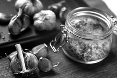 Garlic lying on the table. Food in the house. Medication against. Garlic lying on the table black and white poster Royalty Free Stock Photos
