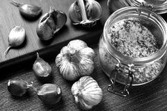 Garlic lying on the table. Food in the house. Medication against. Garlic lying on the table black and white poster Stock Images