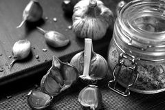 Garlic lying on the table. Food in the house. Medication against. Garlic lying on the table black and white poster Royalty Free Stock Images