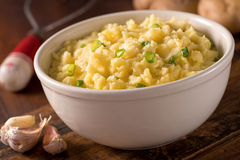 Garlic Mashed Potatoes. A bowl of delicious creamy garlic mashed potatoes with butter and green onions stock photography
