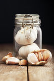 Garlic in Mason Jar on Wooden for Background Uses. Royalty Free Stock Image