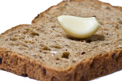 Garlic medicine. Closeup of garlic slice on the rye bread Stock Photos