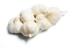 Garlic in Mesh Bag Stock Photo