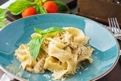 Garlic mushroom pasta pappardelle with creamy sauce stock images