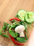 Garlic,mushrooms, chili pepper, parsley, cucumber Royalty Free Stock Image