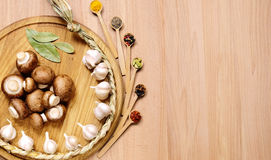 Garlic, mushrooms and spice on wooden table. Stock Images