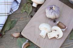 Garlic, mushrooms and spices. Fresh food royalty free stock photos