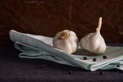 Garlic on a napkin. Food background. Garlics. sliced garlic, garlic clove, garlic bulb. Garlic, onion, bay leaf, black pepper on a napkin. Garlics. sliced royalty free stock image