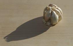 Garlic. Natural shot of a garlic onn a cutting board Stock Photography