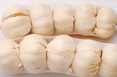 Garlic in net bags Stock Photo