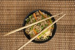 Garlic Noodles with chopsticks, top view, Pune, India. Garlic Noodles with chopsticks, top view, Pune India royalty free stock images