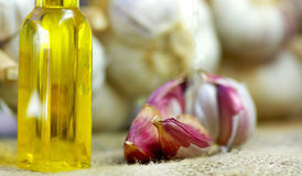 Garlic, oil and candle Royalty Free Stock Photo