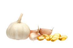 Garlic and oil capsule Stock Images