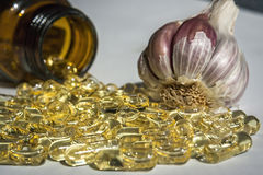 Garlic oil capsules Stock Photo
