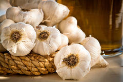Garlic and oil jar, landscape. Stock Image
