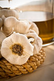 Garlic and oil jar, portrait Stock Photography