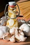 Garlic, oil and spaghetti. In the italian kitchen Stock Image