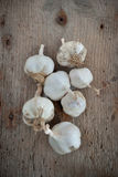 Garlic on an old wooden board Stock Photo