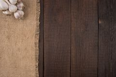 Garlic on old wooden table. Royalty Free Stock Photos