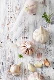 Garlic on an old wooden table. The view from the top. Royalty Free Stock Images