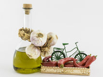 Garlic, olive oil, red pepper in basket. Garlic, olive oil, and red pepper in the basket on white background Royalty Free Stock Photography