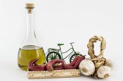 Garlic, olive oil, red pepper in basket. Garlic, olive oil, and red pepper in the basket on white background Royalty Free Stock Photos